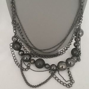 Metal black and silver toned multitiered  necklace